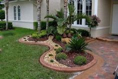 Backyard Landscaping Ideas Change to grey stone and river rock #landscapingideas
