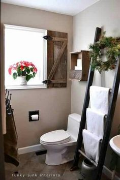 Bathroom ladder rack by the window...