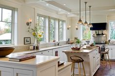 Windows instead of upper cabinets make a unique kitchen in Hanover, NH. Smith & Vansant Architects PC.