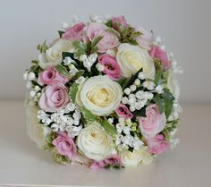 Bouquet of ivory and pale pink roses with bouvardia, pink lisianthus and a touch of fresh green foliage.