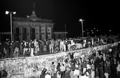 326 East and West German citizens celebrated as they climbed the wall.
