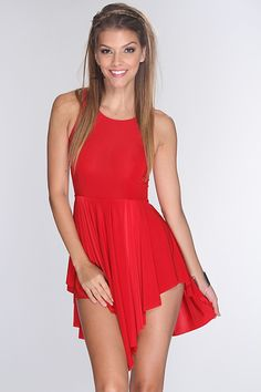 If you are looking for a classy dress that is perfect for your next holiday or cocktail party, then your search is over! Look simply fabulous no matter the occasion with this dress. Youll love it the moment oyu try it on! It features round neckline, sleeveless, pleated, asymmetrical hem, and fitted. 92% Polyester 8% Spandex. Made in USA.