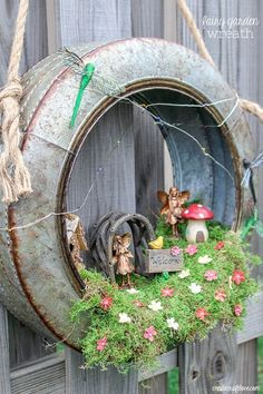 Create a whimsical fairy habitat to welcome spring! This Fairy Garden Wreath will impress any guest! #ad #hobbylobbystyle #hobbylobbymade #gardeninglayout