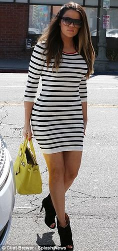 #KhloeKardashian looks great in a striped mini!  Enter to win tickets to the 2014 #Grammys at http://www.DivaMall.tv