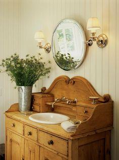 Cottage Powder Room with Vintage bathroom sink cabinets, Kohler - Compass Drop-In Undermount Bathroom Sink, Raised panel