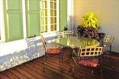 like the table on the porch. Seen on HarmonHomes.com