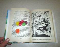 "Six flattened Skittles.  Found in ""The Hunchback of Notre Dame"" by Victor Hugo. Published by Baronet Books, 1994."