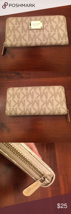 Michael Kors Wallet Cream saffiano leather MK wallet with interior change purse 😊 Exterior has average signs of wear (see pics) interior of wallet in great condition. Inquire for Measurements 🌺 All offers considered!❤️ Bundle and Save! 🌈 KORS Michael Kors Bags Wallets