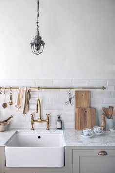 In addition to the Farmhouse Sink, deVol also supplied the Aged Brass Ionian Tap, Brass Cabinet Hardware, handmade Crackle Metro Tiles, and Brass Hanging Rail. tiles A Bigger and Brighter Kitchen: An Ikea Makeover By Our Food Stories Kitchen Ikea, Kitchen Furniture, Kitchen Interior, Furniture Stores, Furniture Outlet, Kitchen Lamps, Cheap Furniture, Discount Furniture, Luxury Furniture