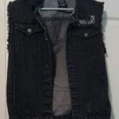 Black Misfits Jean Vest A black Misfits Jean vest. Never worn, new without tags. Unfortunately, while it looks cool, I'm not a fan of the Misfits anymore. Hot Topic Jackets & Coats Vests