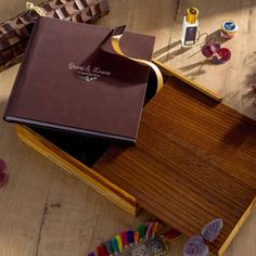 Handcrafted using finest quality wood, this one of its kind leather album in an exquisite pine wood box comes with an exclusive embossed slide-in wooden cover