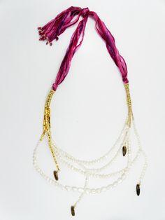 collar rosado con perlas
