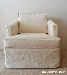 Natural canvas slipcover hides worn, brown fake suede upholstery.