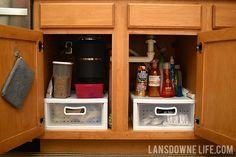 Organizing the cabinet under the kitchen sink - Lansdowne Life
