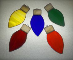 Stained Glass Christmas Bulb Ornaments Set of 5 by stainedglasswv, $24.99. Would be cute as a string of lights.