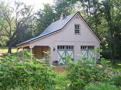 Garage built to look like barn. This car garage has Carriage s… Garage built to look like barn. This car garage has Carriage style overhead doors, loft, metal roof, roof pitch and wide overhang. Pole Barn Garage, Garage Loft, Garage Storage, Barn Storage, Storage Sheds, Garage Shop, Garage Workshop, Dream Garage, Outdoor Storage