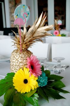 vaptism centerpiece with gold  pineapple and flamingo