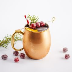 1/2 oz simple syrup 1/2 oz unsweetened cranberry juice 1 1/2 oz gin or vodka 2 oz chilled ginger beer 1 rosemary sprig orange slice, for garnish sugared cranberries, for garnish