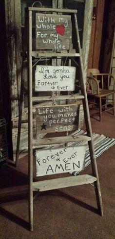 Cute idea for ladder and signs...use pretty painted frames and chalkboard signs. These look hillbilly.