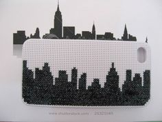 New York Silhouette Cross Stitched on an iPhone cover by @Aylin.