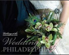 Our wedding bouqeut with orchids and peacock feathers featured.