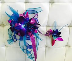 Blue bom dendrobium orchids lend a perfect touch to this fuchsia plated leaf and ribbon bracelet.