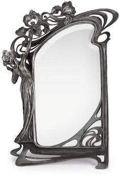 An Art Nouveau pewter figural mirror in the manner of WMF