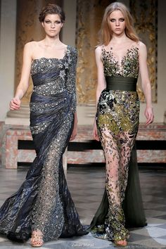On the fashion runway of Zuhair Murad's couture collection - two sparkly evening gowns