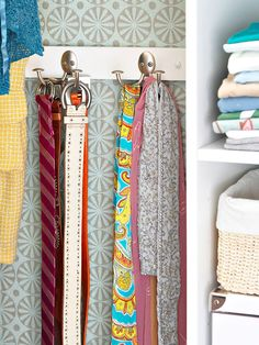 Hang hooks to hold belts and scarves. Be sure to either find a stud behind the wall or use a wooden bracket as shown.