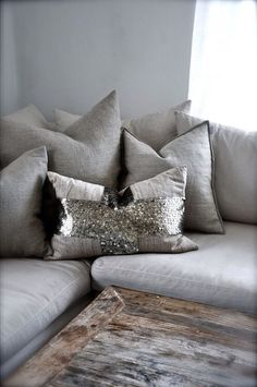Sequin Pillow, Greys and wooden coffee table.