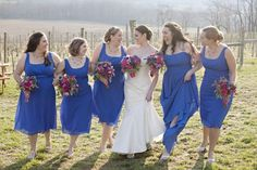 Bright-Royal-Blue-Bridesmaids. I like the pink flowers with the blue dress.