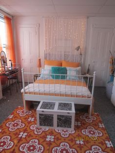 Small apartment decorated on a budget using thrift store and yard sale up-cycles.., orange, white, aqua Dorm Rooms Design