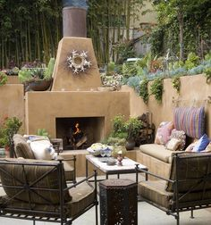 An adobe fireplace creates a warm atmosphere any time of year. Image courtesy of Sandy Koepke.