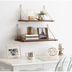 Constructed with a reliably sturdy wooden material and finished in a mid-century modern walnut brown, these shelves were made not to chip or fade over time. The thick metal wire is a lovely brass color and is twisted around the shelf twice to add strength The larger shelf is 24 inches long x 9 inches deep, and the smaller shelf is 19 inches long and the same depth. The shorter shelf is... Shelves Above Desk, Corner Wall Shelves, Wall Bookshelves, Large Shelves, Wall Mounted Shelves, Hanging Shelves, Wooden Shelves, Floating Shelves, Floating Wall