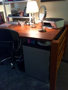 Dorm desk set up. Mini Refrigerator under. You're going to want a makeup mirror. We found this one that is battery operated at IKEA. Maybe $15? Buy it. Another top 5 item for the dorm room.