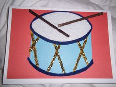 """Drum card. Simple, but adorable! Several layers (2 layers of card stock & 2 layers or felt) plus """"sticks"""" as drum sticks."""
