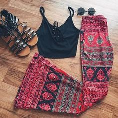 Today's outfit of the day >> We love the way our Lace Up Crop Top pairs with our Gypsy Printed Bell Bottoms! We completed this look with some sunnies and lace up sandals.