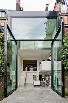 The Largest Glass Pivoting Doors In The World. Antwerp, Belgium. 3m wide, 6m high and weighs 2 tons each!