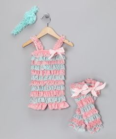 Little frill-seekers will love the lace that circles about this stretchy romper. The matching headband and leg warmers are the pretty points that put on quite the show.