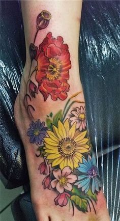 Assorted flower tattoos on foot - Different hues and kinds of flowers. It's never wrong. #TattooModels #tattoo