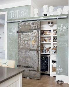 sliding barn door + chalkboard wall + wine refrigerator in pantry. Love it all!