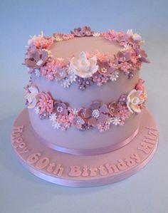 Pretty 60th Birthday Cake, via Flickr. Fondant flowers