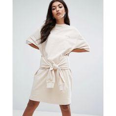 Ellesse Oversized Sweat T-Shirt Dress With Tie Waist (160 ILS) ❤ liked on Polyvore featuring dresses, cream, cotton tee dress, tee dress, pattern dress, oversized dress and cotton t shirt dress