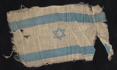 The flag of Israel raised by Holocaust Survivor Eleazar (Spiegel) Shafrir upon hearing the results of the vote in the UN on the 29th of November 1947 approving the creation of the State of Israel