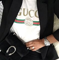 Literally Everyone Has This Gucci T-Shirt #refinery29  http://www.refinery29.com/2016/12/134182/gucci-logo-t-shirt-trend#slide-18  Suit it up....