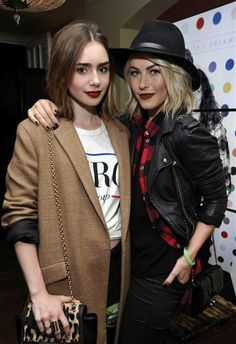 Lily Collins and Julianne Hough attend a celebration of Thirty Seconds to Mars' Love, Lust, Faith and Dreams tour presented by Samsung Galaxy at the Chateau Marmont in Los Angeles on Oct. 12, 2013.