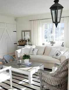 Black and White Beach Cottage Living Room.... http://www.completely-coastal.com/2017/01/coastal-decor-in-black-white-pillows.html