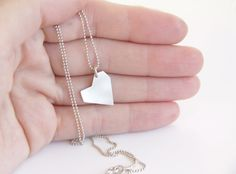 The perfect gift for Valentine's Day! A sterling silver asymmetrical heart necklace.The heart is made out of sterling silver, has a brushed matte finish, and ha Silver Pendant Necklace, Sterling Silver Necklaces, Arrow Necklace, Valentine Day Gifts, Valentines, Milk Shop, Geometric Heart, Handmade Sterling Silver, Ball Chain