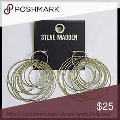 """STEVE MADDEN SPARKLE HOOP EARRINGS STEVE MADDEN SPARKLE EARRINGS Statement Silver Hoops  COLOR: SILVER  ABOUT THIS ITEM * Sparkly glam multi hoops design * Allover shimmery construction  * Silver-tone textured finish * French hook back * High quality & well made  * Approx 3.25""""L X 2""""W MATERIAL Silver-tone metal  ❌NO TRADES❌ ✅BUNDLE DISCOUNTS ✅ OFFERS CONSIDERED (Via the offer button only)   SEARCH WORDS # boho metallic embellished glitter Steve Madden Jewelry Earrings"""