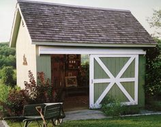 Cute green shed with sliding barn style door
